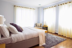 Bedroom with white walls and wooden floors