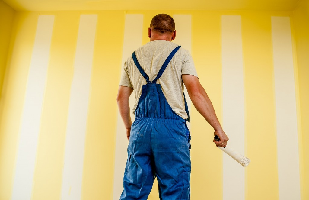 Painter painting a room.