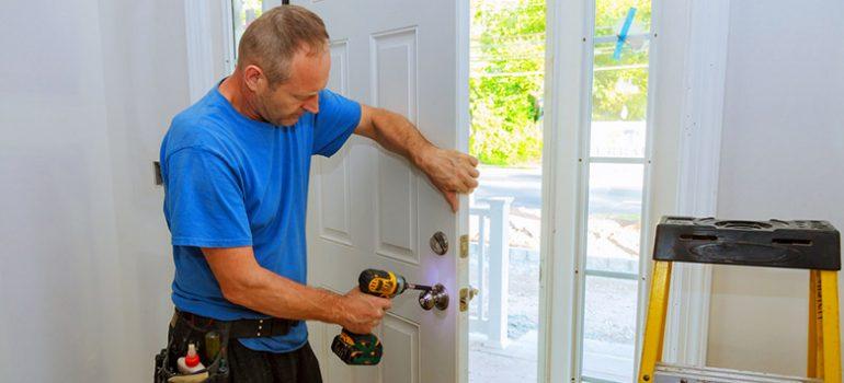 Man fixing a door.
