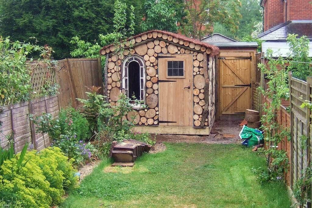 Beautiful log inspired shed.